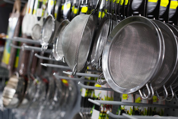 Image of shelfs with dishes in the kitchen department in the store.
