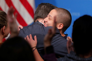 """Survivor of the mass shooting at the Marjory Stoneman Douglas High School Gonzalez is embraced while being welcomed to discuss the """"#NeverAgain"""" push in Cambridge"""