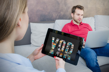Woman using digital tablet for watching movie on VOD service