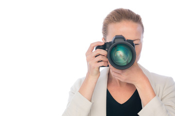 Woman photographer taking images with dslr camera isolated on white background.