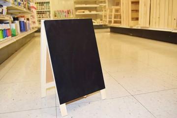 Blank black chalk board in a store setting