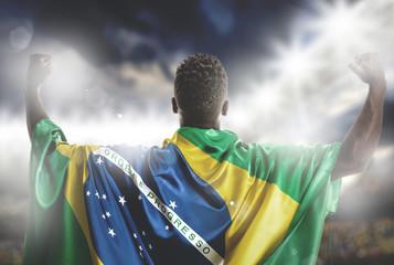 Brazilian soccer player celebrating in the stadium