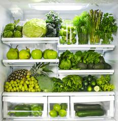 Fresh green vegetables and fruits in fridge.