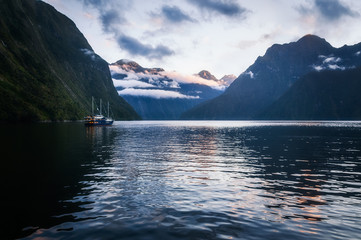 Milford Sound over night cruise stops in beautiful Harrison Cove for sunset. Milford Sound is a fiord and the most beautiful natural feature of New Zealand's Southern Island.