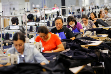 Workers make jackets at the Canada Goose factory in Toronto