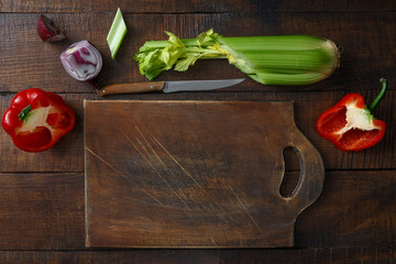 Wooden cutting board fresh vegetables wooden table top view