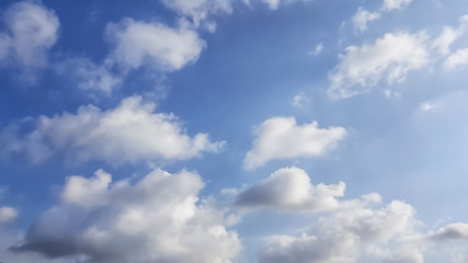 Many white clouds in the blue sky background,Big cloud floating in sky. The weather is clear today
