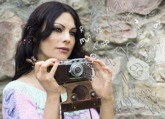 The woman with the camera and zodiac signs