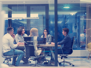 Startup Business Team At A Meeting at modern night office building
