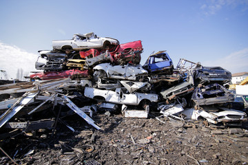 Pile of used old cars at a scrapheap junkyard