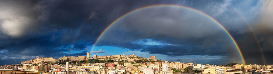 Panoramic view of Cagliari harbor with rainbow after the rain