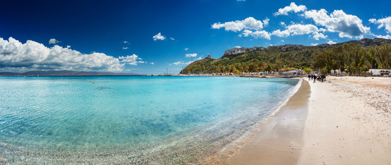 "Panoramic view of Poetto's Beach with ""Sella Del Diavolo"" promontory on background, in Cagliari, Sardinia"