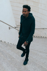 African black man climbing stairs
