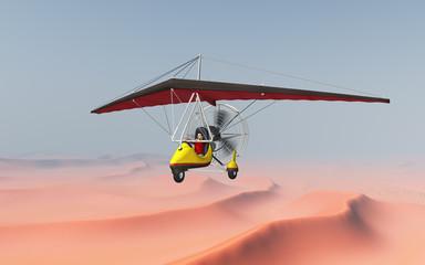 Ultraleichtflugzeug über einer Sandwüste