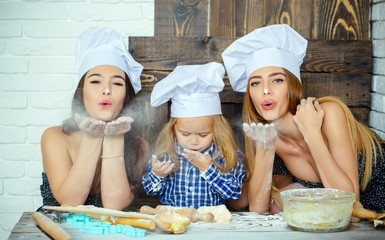 Brother and sisters blowing flour