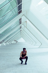 Man urban and sporty style in modern and futuristic buildings