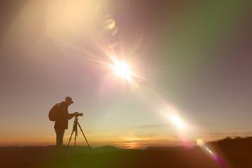 Photographe en haut des montagnes