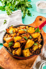 Indian food, Bombay Potatoes on light blue background copy space