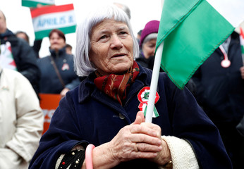 Woman attends Hungarian march at a pro-Orban rally during Hungary's National Day celebrations in Budapest