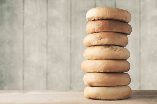 High Bagel Stack on Wood with Planked Background