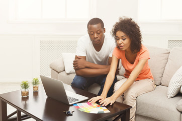 African-american couple discussing interior design