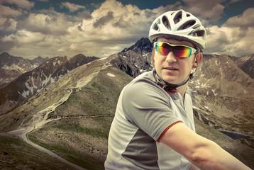 Men with bicycle aroun mountains beautiful view.