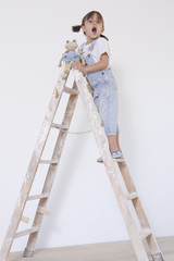 little girl up on a ladder