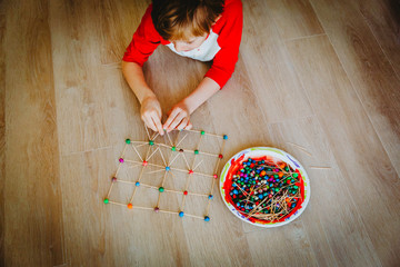 child making geometric shapes, engineering and STEM education