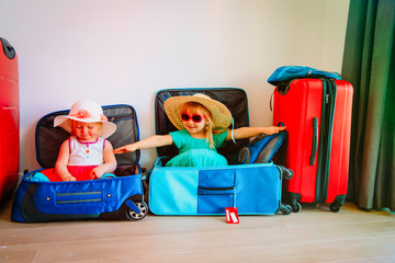 little girls enjoy packing and travel, family going on vacation