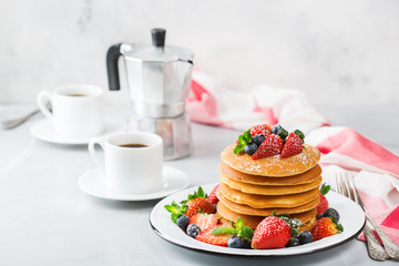 Stack of homemade pancakes for breakfast with berries