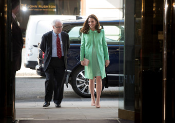 Britain's Catherine, Duchess of Cambridge is greeted by Simon Charles Wessely at the Royal Society of Medicine, in London