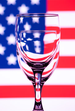 Two glasses for wine, one after another with a colored background