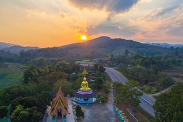 aerial photography the golden buddha statue at wat Sirattanan Mongkol near Mae Kajan Hot Spring. Wiang Pa Pao Chiang Rai Thailand.