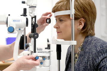 Scotland's First Minister, Nicola Sturgeon, is given an eye test by ophthalmologist Ida Boron, during a visit to the Out-Patients Department at the new East Lothian Community Hospital in Haddington