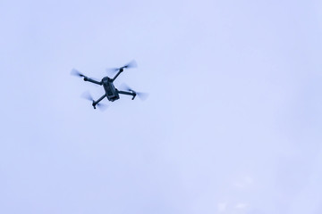 flying drone against blue sky