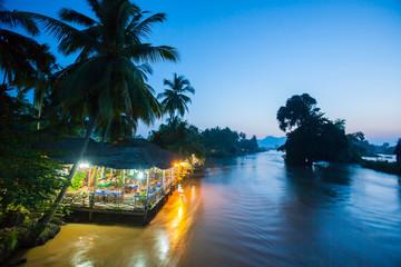 Riverside restaurant near Mekong River in twilight