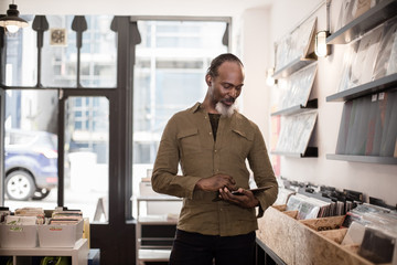 Small business owner using digital tablet in a record store