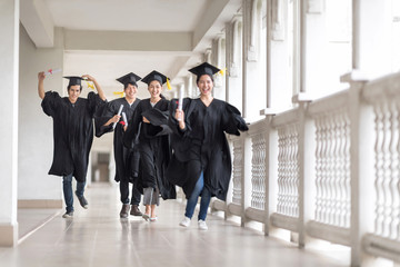 Graduation day, Images of Happily graduates are celebrating graduation, graduate are running to their family, Happiness feeling, Commencement day, Congratulation. Education Concept.