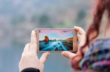 woman taking a picture with the smartphone