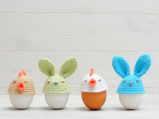 Easter holiday eggs with bunny ears on white wooden table. Easter ideas