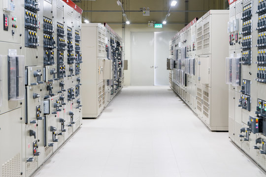 Electrical Room, medium and high voltage switcher, equipment, panel to control and protect the electrical equipment and system by fuse, circuit breaker, control panel at  power plant and substation