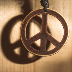 Symbol of peace love and not war of wood with shadow