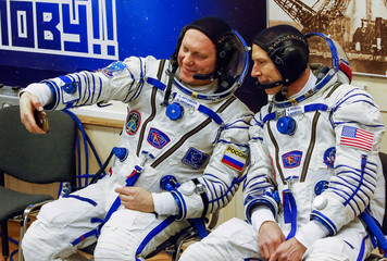 The International Space Station (ISS) crew members astronauts Feustel of the U.S. and his crew mate Artemyev of Russia take a selfie after donning space suits shortly before their launch at the Baikonur Cosmodrome