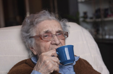 Elderly woman enjoying at home.
