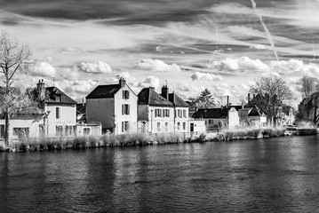 Old calm house on riverside in Auxerre, infrared view