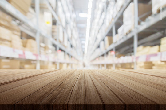 wood plank table top with warehouse store blur background for your product