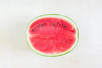 Watermelon cut half on wooden table