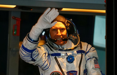 The International Space Station (ISS) crew member astronaut Drew Feustel of the U.S waves from a bus shortly before leaving to board the spacecraft at the Baikonur Cosmodrome