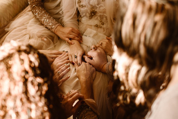 A Group of Woman Holding Multiple Hands and Praying