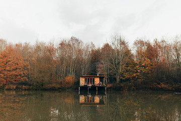 Woman on porch at pond